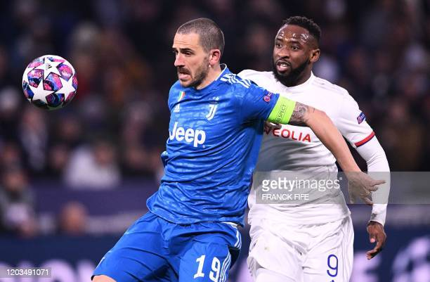 Juventus' Italian defender Leonardo Bonucci is challenged by Lyon's French forward Moussa Dembele during the UEFA Champions League round of 16...