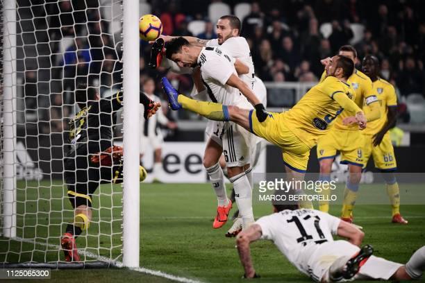 TOPSHOT Juventus' Italian defender Leonardo Bonucci jumps with Juventus' German midfielder Sami Khedira to score the 20 goal during the Italian Serie...