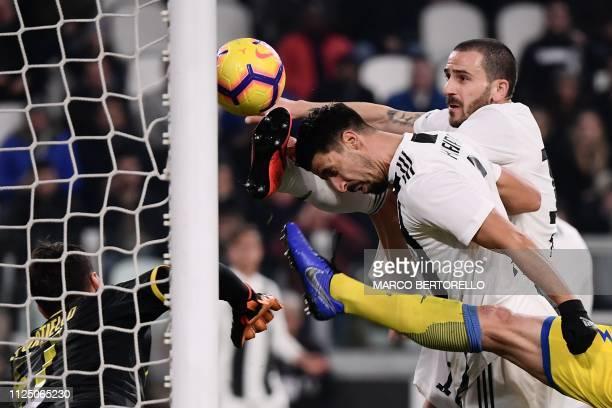 Juventus' Italian defender Leonardo Bonucci , next to Juventus' German midfielder Sami Khedira scores the 2-0 goal during the Italian Serie A...