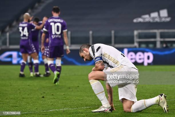 Juventus' Italian defender Leonardo Bonucci reacts as Fiorentina's players celebrate after Juventus scored an own goal during the Italian Serie A...