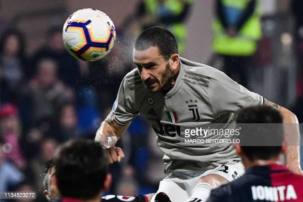 Juventus' Italian defender Leonardo Bonucci scores a header during the Italian Serie A football march Cagliari vs Juventus on April 2 2019 at the...
