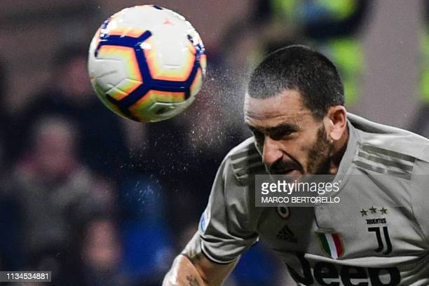 Juventus' Italian defender Leonardo Bonucci scores a header during the Italian Serie A football march Cagliari vs Juventus on April 2 2019 at the...