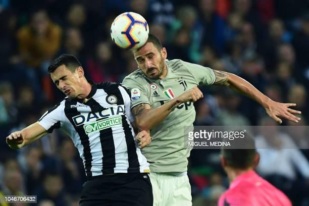 Juventus' Italian defender Leonardo Bonucci vies for the ball with Udinese's Italian forward Kevin Lasagna during the Italian Serie A football match...