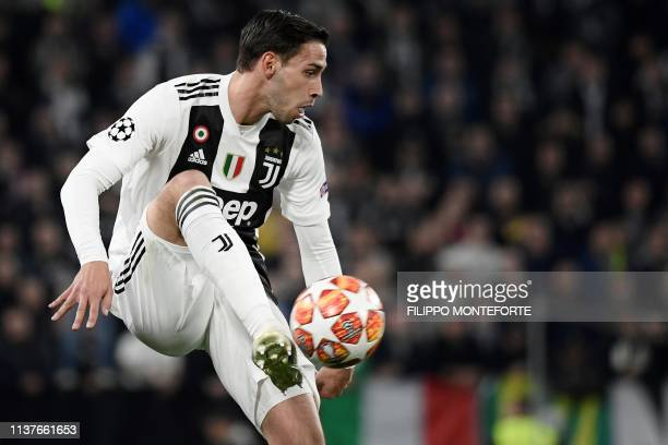 Juventus' Italian defender Mattia De Sciglio controls the ball during the UEFA Champions League quarterfinal second leg football match Juventus vs...