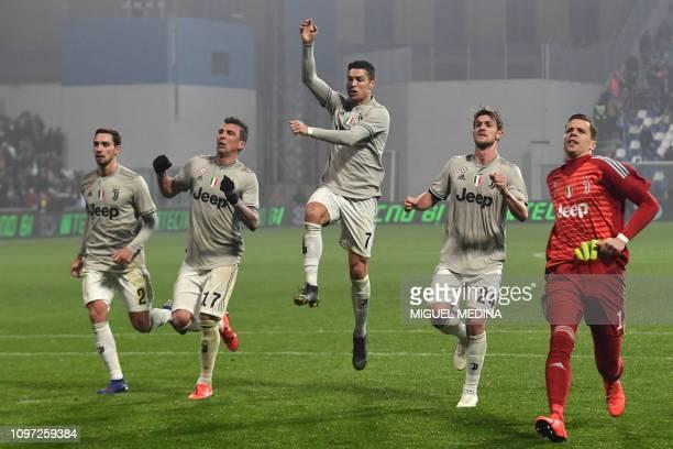 Juventus' Italian defender Mattia De Sciglio Juventus' Croatian forward Mario Mandzukic Juventus' Portuguese forward Cristiano Ronaldo Juventus'...