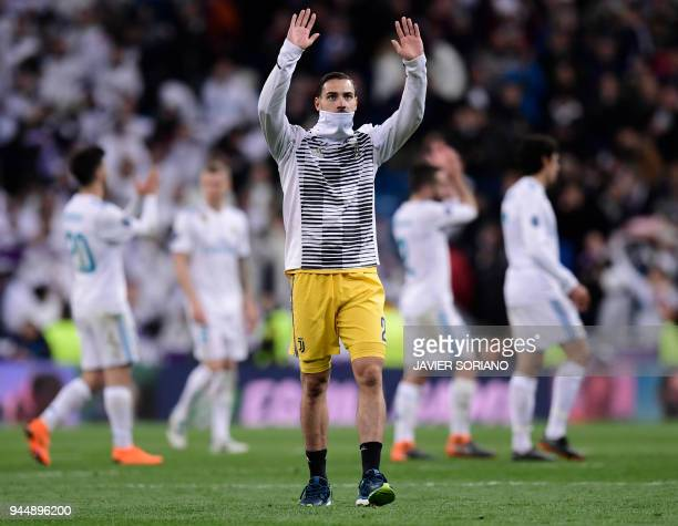 Juventus' Italian defender Mattia De Sciglio waves to supporters at the end of the UEFA Champions League quarterfinal second leg football match...
