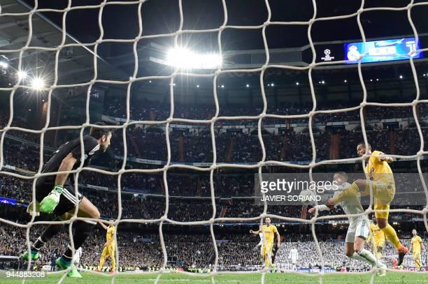 Juventus' Italian defender Medhi Benatia vies with Real Madrid's Spanish midfielder Lucas Vazquez in front of Juventus' Italian goalkeeper Gianluigi...