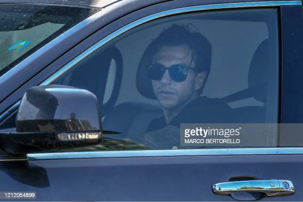 Juventus' Italian forward Federico Bernardeschi arrives in his car for training at the club's Continassa training ground in Turin on May 7 2020...