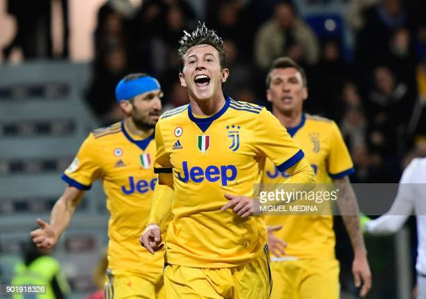 Juventu's Italian forward Federico Bernardeschi celebrates after scoring during the Italian Serie A football match between Cagliari Calcio and...