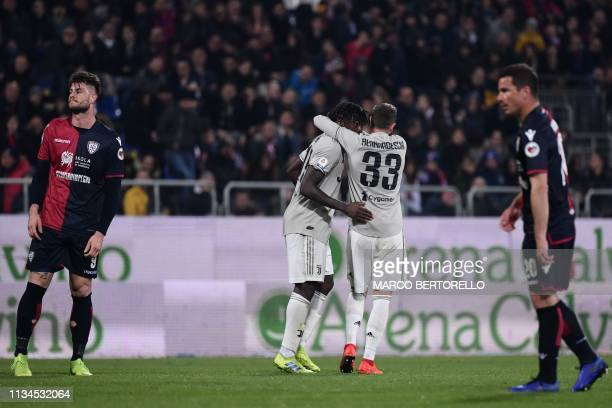 Juventus' Italian forward Federico Bernardeschi holds Juventus' Italian forward Moise Kean after Kean scored during the Italian Serie A football...