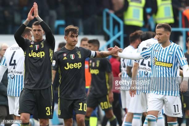 Juventus' Italian forward Federico Bernardeschi Juventus' Argentine forward Paulo Dybala and SPAL's Italian midfielder Alessandro Murgia react at the...