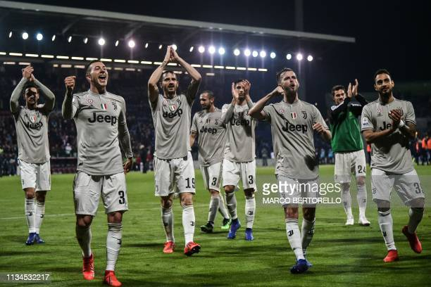 Juventus' Italian forward Federico Bernardeschi Juventus' Italian defender Leonardo Bonucci Juventus' Bosnian midfielder Miralem Pjanic and Juventus'...