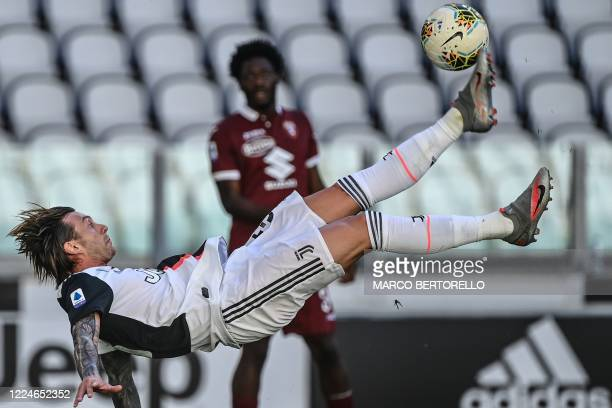 Juventus' Italian forward Federico Bernardeschi shoots a overhead kick during the Italian Serie A football match Juventus vs Torino played behind...