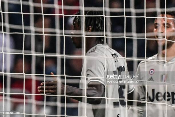 Juventus' Italian forward Moise Kean celebrates in front of Cagliari's fans after scoring during the Italian Serie A football march Cagliari vs...