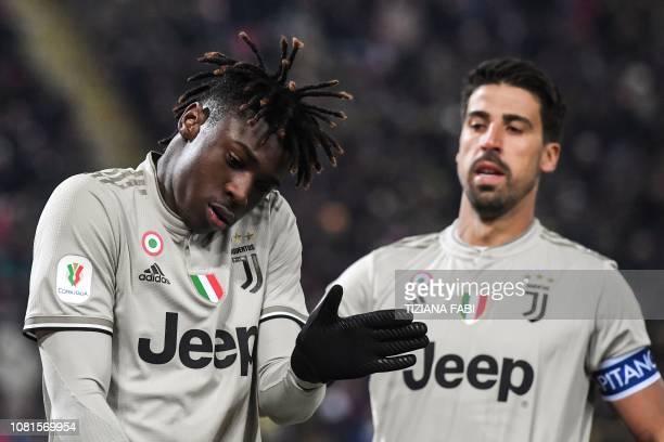 Juventus' Italian forward Moise Kean celebrates next to Juventus' German midfielder Sami Khedira after scoring during the Italian Tim Cup round of...