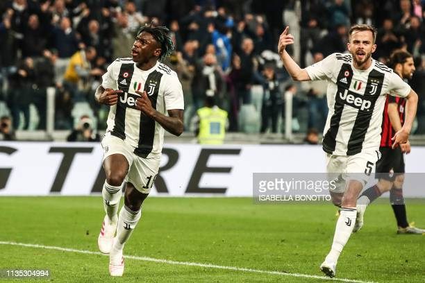 Juventus' Italian forward Moise Kean celebrates with Juventus' Bosnian midfielder Miralem Pjanic after scoring during the Italian Serie A football...