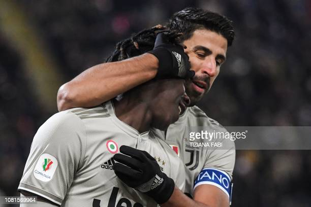 Juventus' Italian forward Moise Kean celebrates with Juventus' German midfielder Sami Khedira after scoring during the Italian Tim Cup round of...