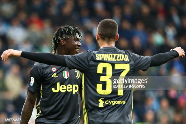 Juventus' Italian forward Moise Kean celebrates with Juventus' Italian defender Leonardo Spinazzola after opening the scoring during the Italian...
