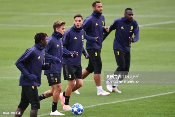 Juventus' Italian forward Moise Kean Juventus' Argentine forward Paulo Dybala Juventus' Uruguayan midfielder Rodrigo Bentancur Juventus' Moroccan...