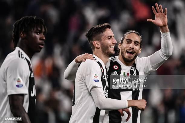 Juventus' Italian forward Moise Kean Juventus' Uruguayan midfielder Rodrigo Bentancur and Juventus' Uruguayan defender Martin Caceres celebrate at...