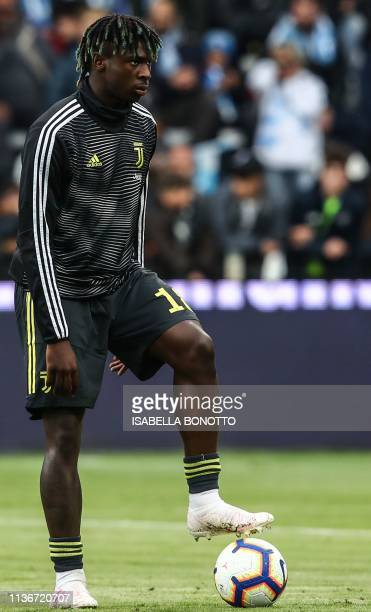 Juventus' Italian forward Moise Kean looks on as he warms up prior to the Italian Serie A football match SPAL 2013 vs Juventus on April 13 2019 at...