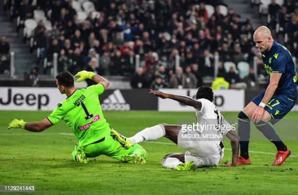 Juventus' Italian forward Moise Kean opens the scoring despite Udinese's Argentine goalkeeper Juan Musso and Udinese's Dutch defender Bram Nuytinck...