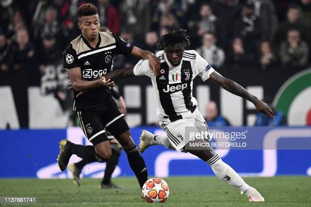 Juventus' Italian forward Moise Kean outruns Ajax's Brazilian forward David Neres during the UEFA Champions League quarterfinal second leg football...