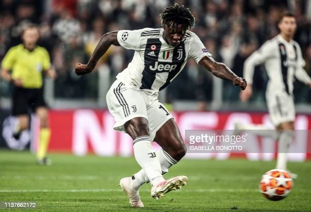 Juventus' Italian forward Moise Kean shoots on goal during the UEFA Champions League quarterfinal second leg football match Juventus vs Ajax...