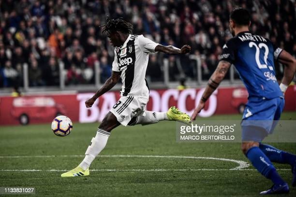 TOPSHOT Juventus' Italian forward Moise Kean shoots to open the scoring during the Italian Serie A football match Juventus vs Empoli on March 30 2019...