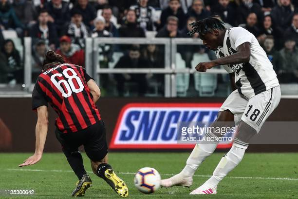 Juventus' Italian forward Moise Kean shoots to score despite AC Milan's Swiss defender Ricardo Rodriguez during the Italian Serie A football match...