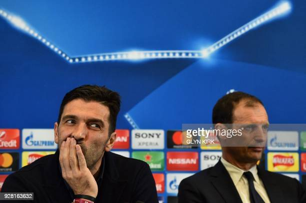 Juventus' Italian goalkeeper Gianluigi Buffon and Juventus' manager Massimiliano Allegri attend a press conference at Wembley Stadium in north London...