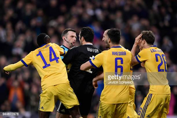 TOPSHOT Juventus' Italian goalkeeper Gianluigi Buffon argues with British referee Michael Oliver during the UEFA Champions League quarterfinal second...