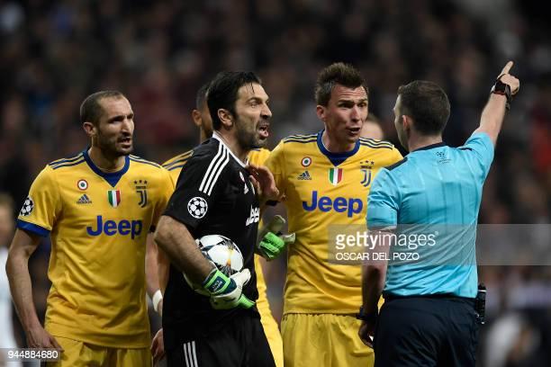 Juventus' Italian goalkeeper Gianluigi Buffon argues with the referee during the UEFA Champions League quarterfinal second leg football match between...