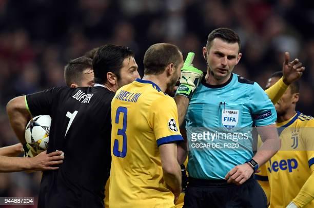 TOPSHOT Juventus' Italian goalkeeper Gianluigi Buffon argues with the referee during the UEFA Champions League quarterfinal second leg football match...