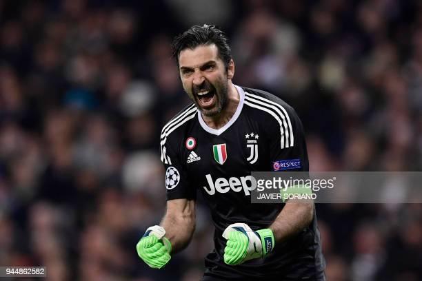 TOPSHOT Juventus' Italian goalkeeper Gianluigi Buffon celebrates after Juventus' French midfielder Blaise Matuidi scored during the UEFA Champions...