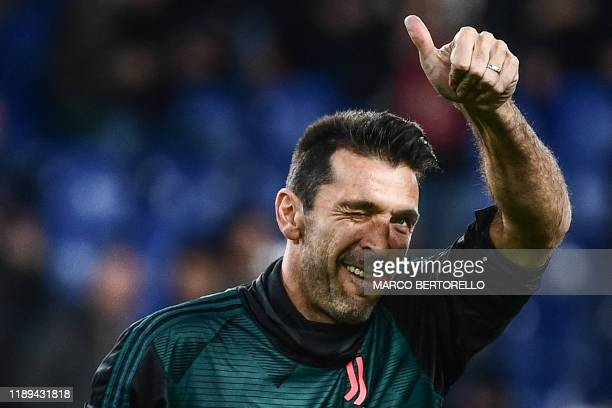 Juventus' Italian goalkeeper Gianluigi Buffon celebrates prior to playing his 647th Serie A game equaling a record set by former Italian AC Milan...