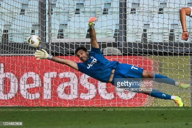 Juventus' Italian goalkeeper Gianluigi Buffon concedes a penalty during the Italian Serie A football match Juventus vs Torino played behind closed...