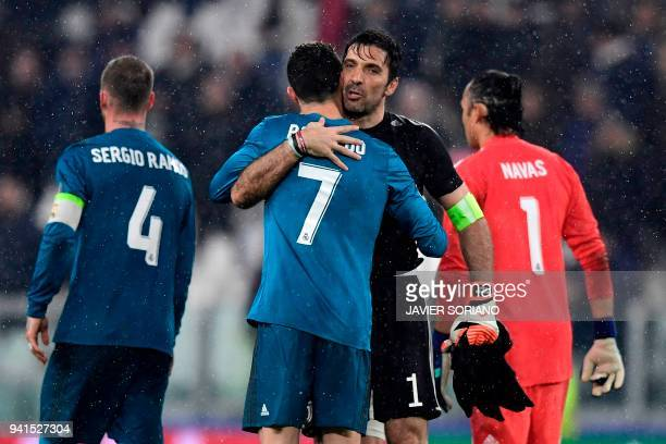 Juventus' Italian goalkeeper Gianluigi Buffon congratulates Real Madrid's Portuguese forward Cristiano Ronaldo at the end of the UEFA Champions...