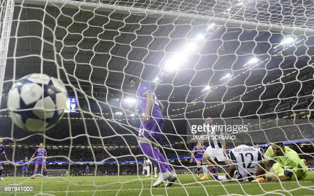TOPSHOT Juventus' Italian goalkeeper Gianluigi Buffon fails to stop a goal from Real Madrid's Spanish midfielder Marco Asensio during the UEFA...