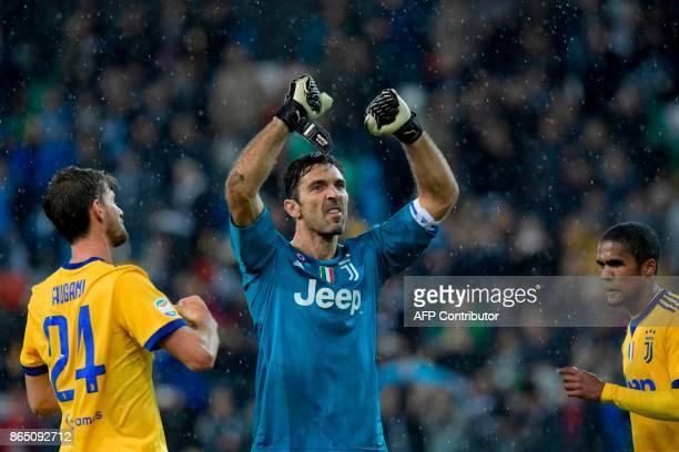 Juventus' Italian goalkeeper Gianluigi Buffon gestures after victory in the Italian Serie A football match Udinese vs Juventus at the Friuli stadium...