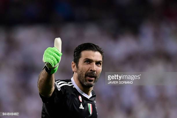 TOPSHOT Juventus' Italian goalkeeper Gianluigi Buffon gives the thumb up during the UEFA Champions League quarterfinal second leg football match...