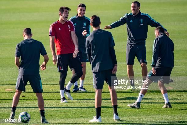 Juventus' Italian goalkeeper Gianluigi Buffon, Juventus' Portuguese forward Cristiano Ronaldo and Juventus' Italian defender Leonardo Bonucci joke...