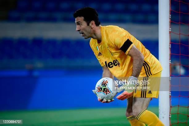 Juventus' Italian goalkeeper Gianluigi Buffon prepares to clear the ball during the TIM Italian Cup final football match Napoli vs Juventus on June...