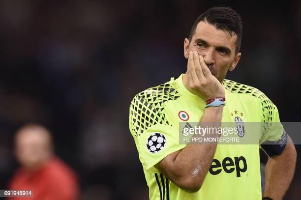 TOPSHOT Juventus' Italian goalkeeper Gianluigi Buffon reacts after Real Madrid won the UEFA Champions League final football match between Juventus...