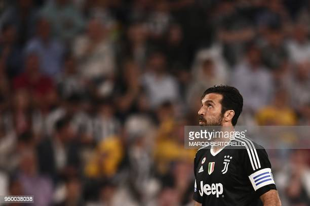 Juventus' Italian goalkeeper Gianluigi Buffon reacts during the Italian Serie A football match Juventus versus Napoli on April 22 2018 at the Allianz...