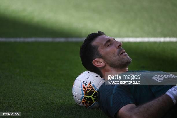 Juventus' Italian goalkeeper Gianluigi Buffon reclines on a ball as he warms up prior to the Italian Serie A football match Juventus vs Torino played...