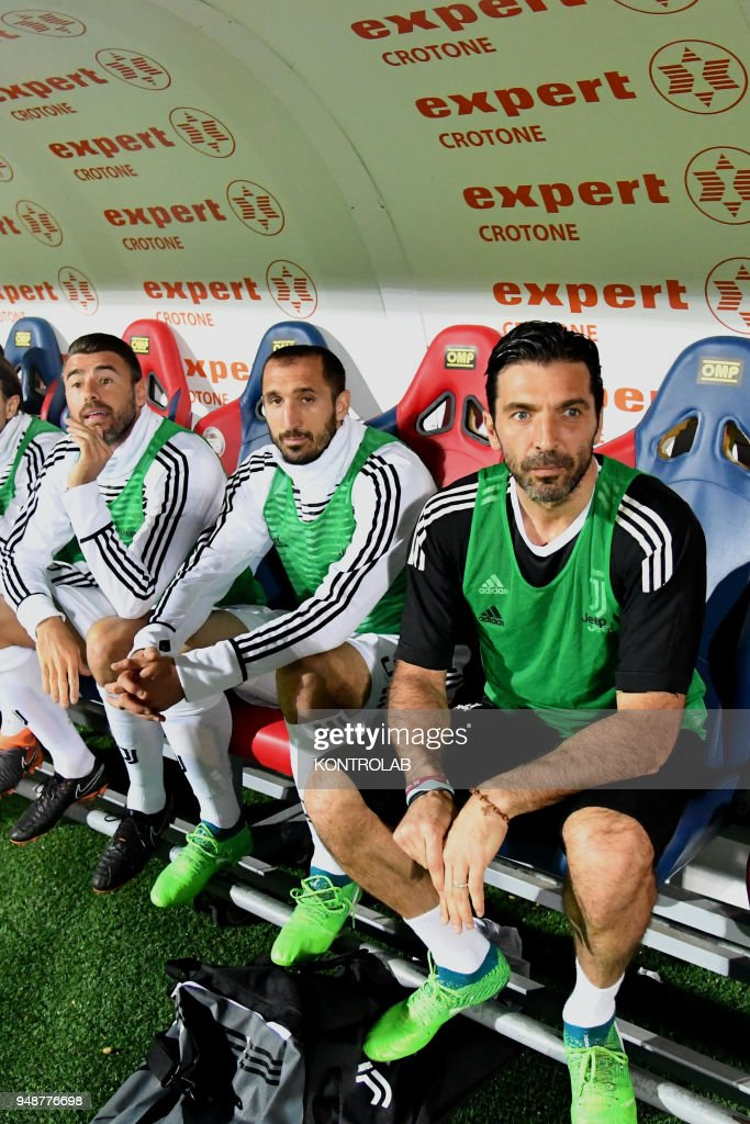 Juventus' Italian goalkeeper Gianluigi Buffon stay on the bench with