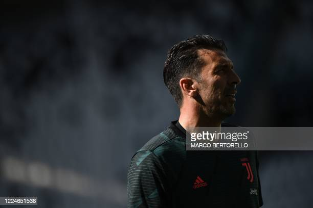Juventus' Italian goalkeeper Gianluigi Buffon warms up prior to the Italian Serie A football match Juventus vs Torino played behind closed doors on...