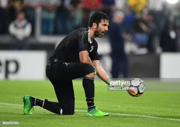 Juventus' Italian goalkeeper Gianluigi Buffon warms up prior to the Italian Serie A football match Juventus versus Napoli on April 22 2018 at the...
