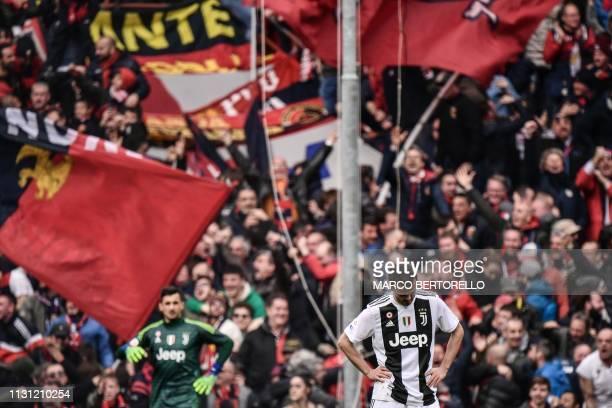 Juventus' Italian goalkeeper Mattia Perin and Juventus' Bosnian midfielder Miralem Pjanic react after conceding a goal during the Italian Serie A...